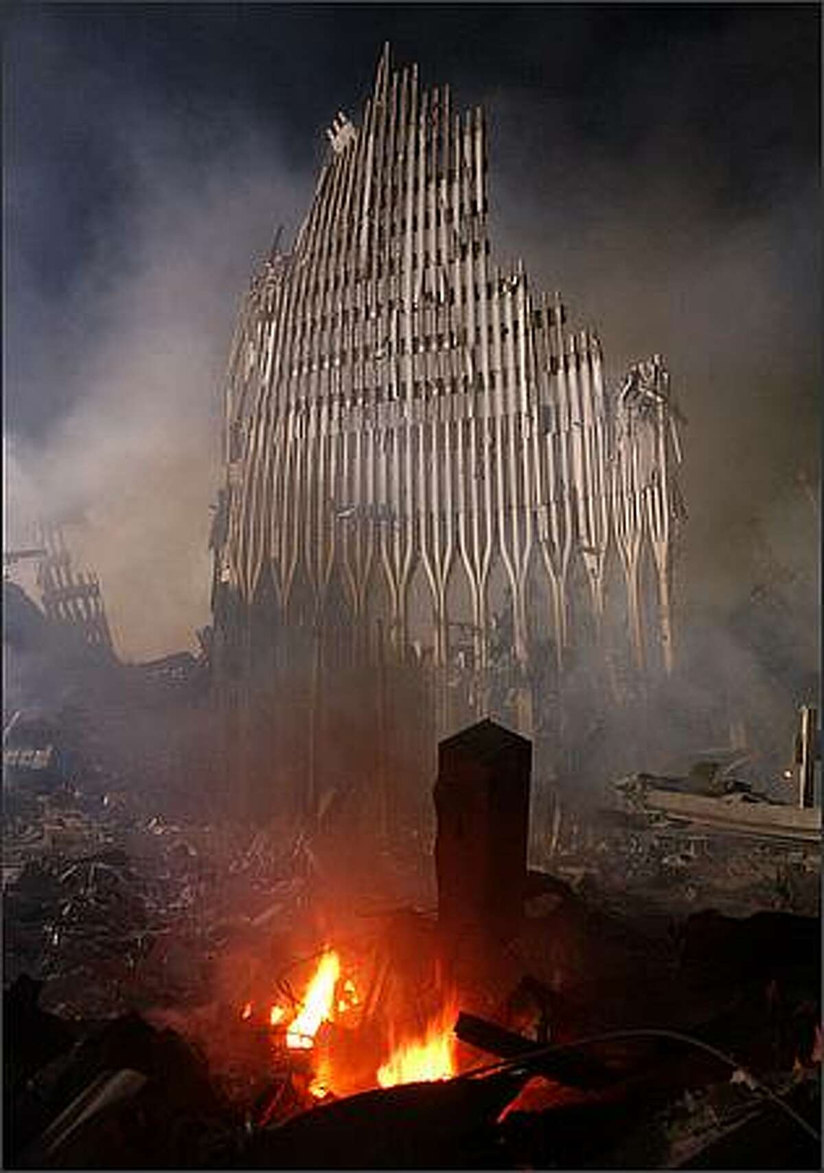 Rubble burns at the remains of the destroyed World Trade Center towers September 12, 2001 in New York City. (Photo by Spencer Platt/Getty Images)