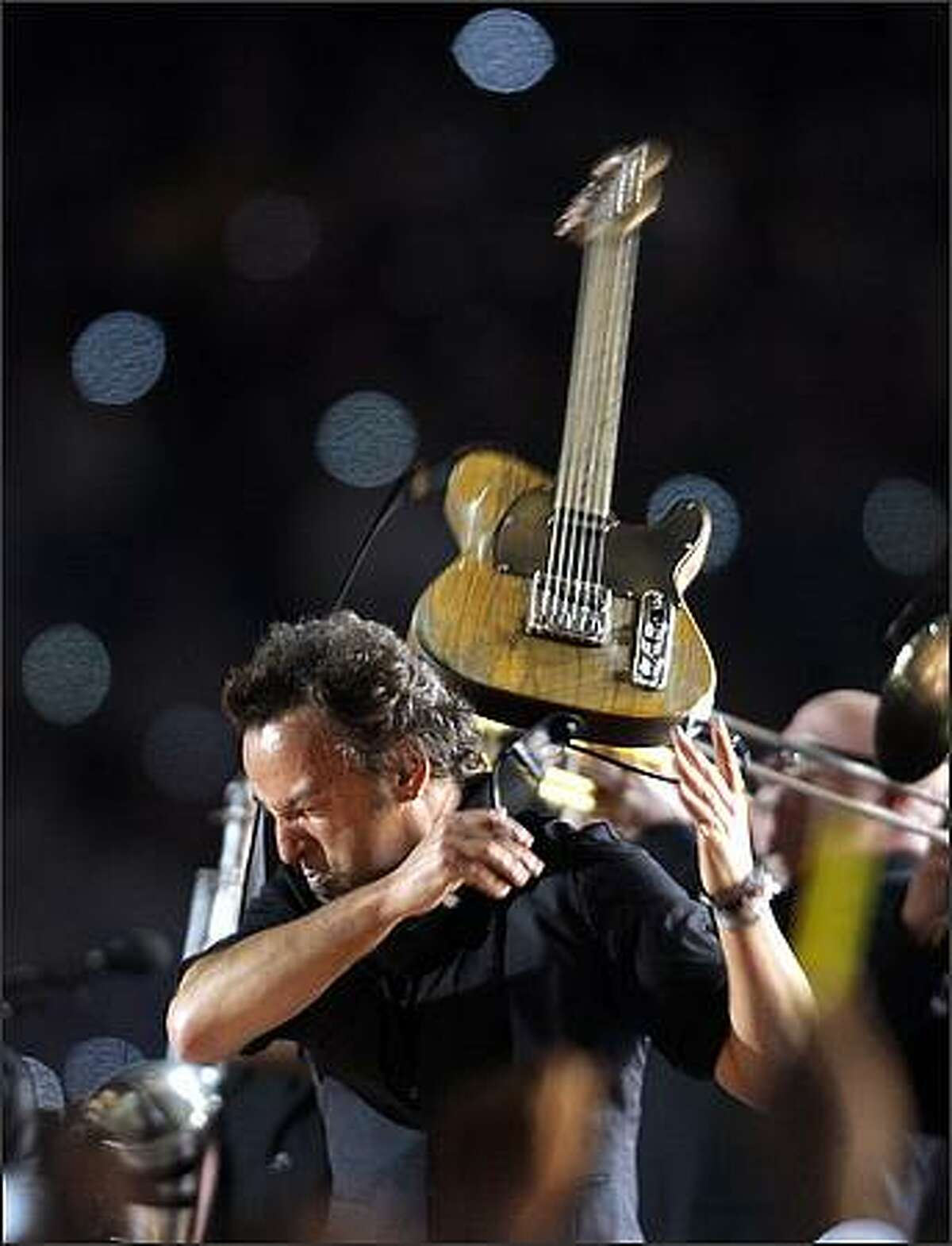 Bruce Springsteen performs at halftime during Super Bowl XLIII. (AP Photo/Amy Sancetta)