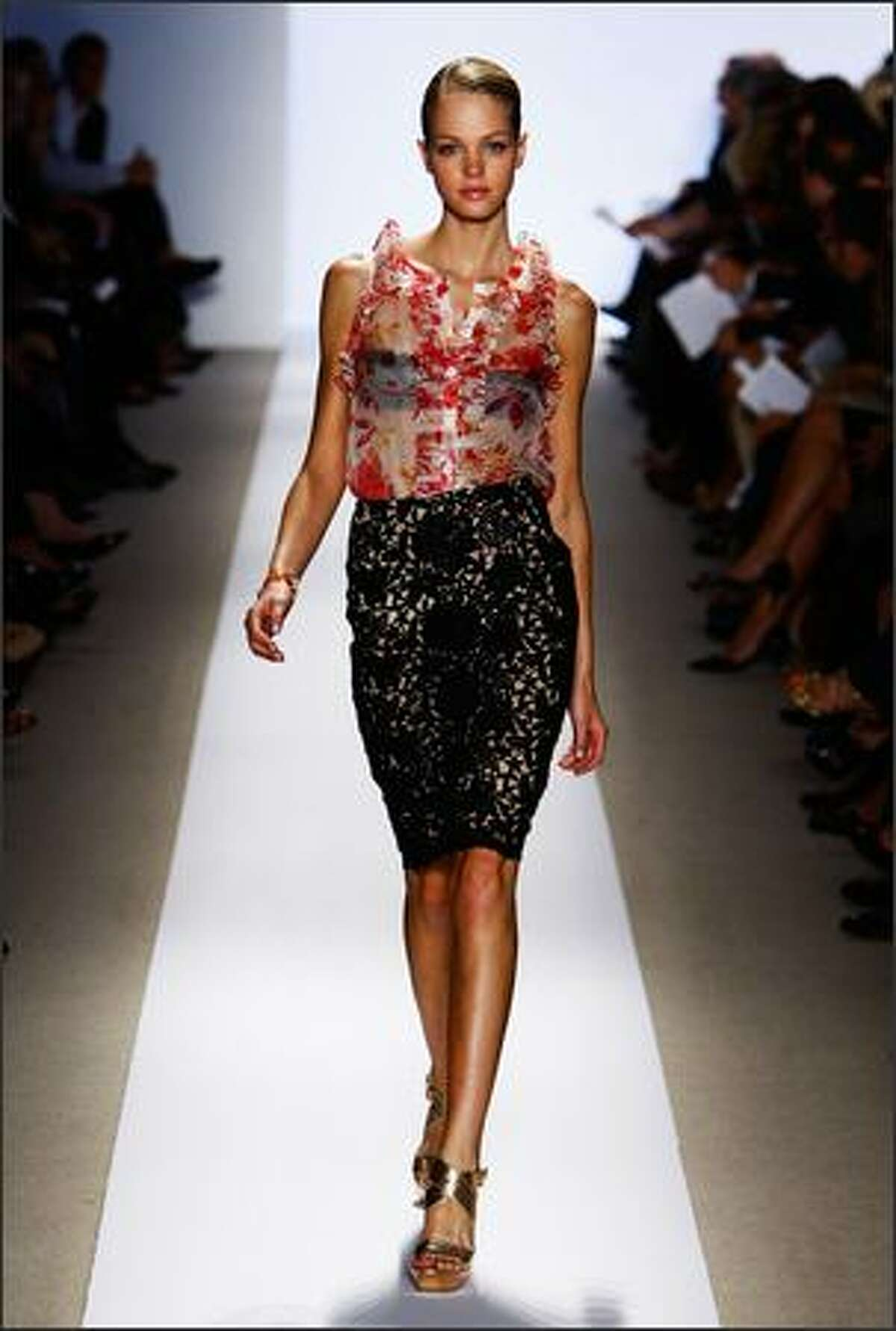 A model walks the runway at the Badgley Mischka show.