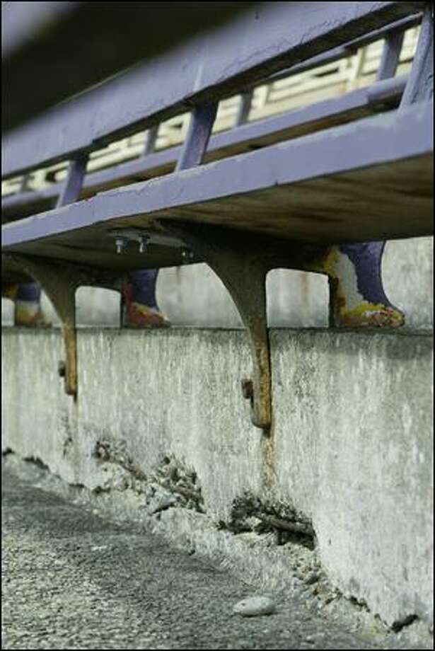 Lateral cracks in the concrete that makes up the lower bowl of Husky Stadium can be seen beneath the bleachers. Photo: P-i File/2007