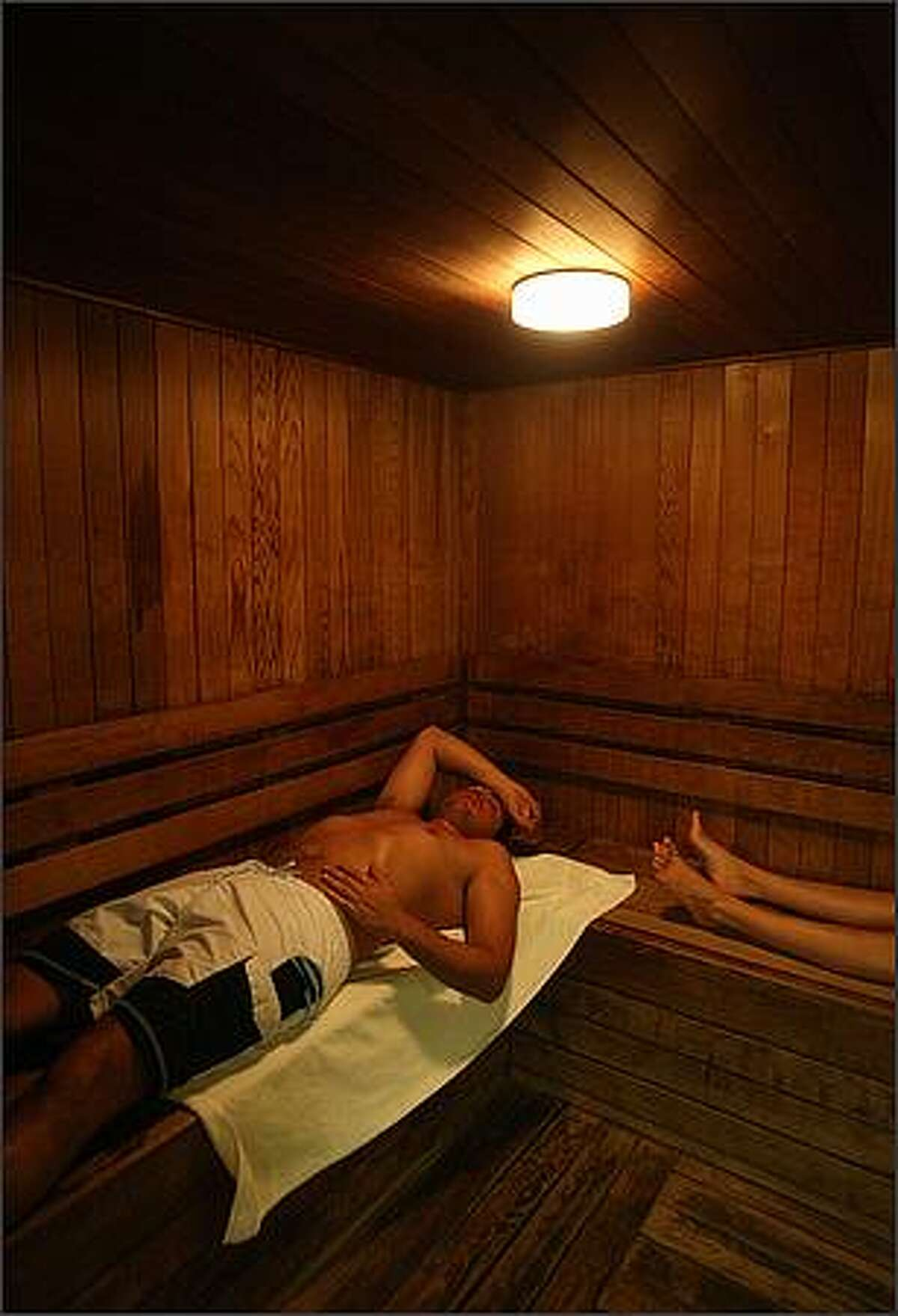 Braulio Santos lies in the sauna with his wife, Paulina, both from Mexico City, while on their honeymoon at the Fairmont Chateau in Whistler, British Columbia. Dec. 11, 2008