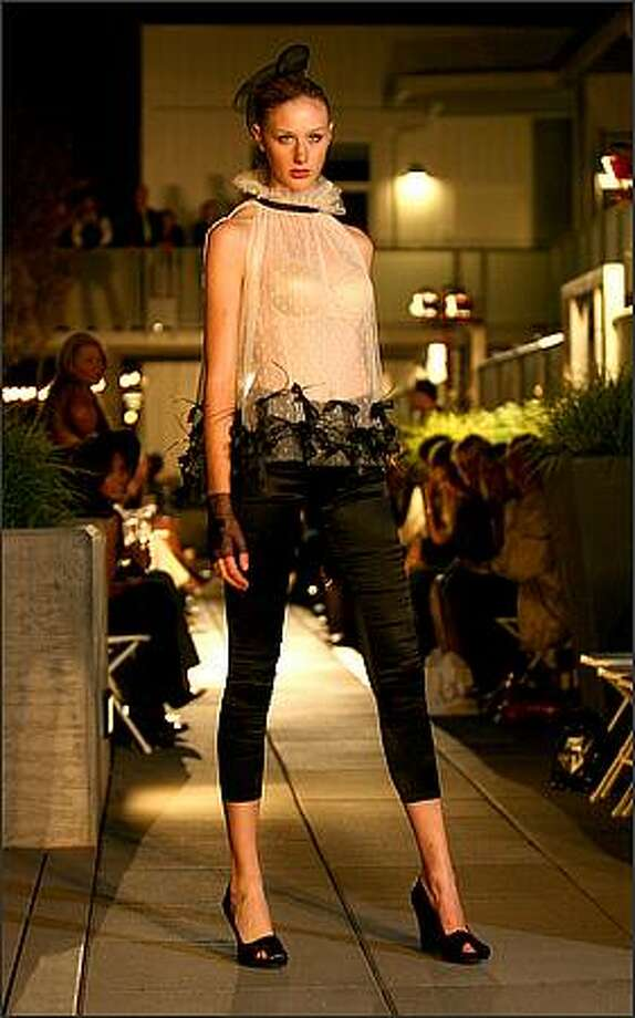 Madina Vadache unveiled her Spring 2009 ready-to-wear collection, Liquid Dreams at the Lumen Garden Courtyard in Seattle. Photo: Scott Eklund, Seattle Post-Intelligencer