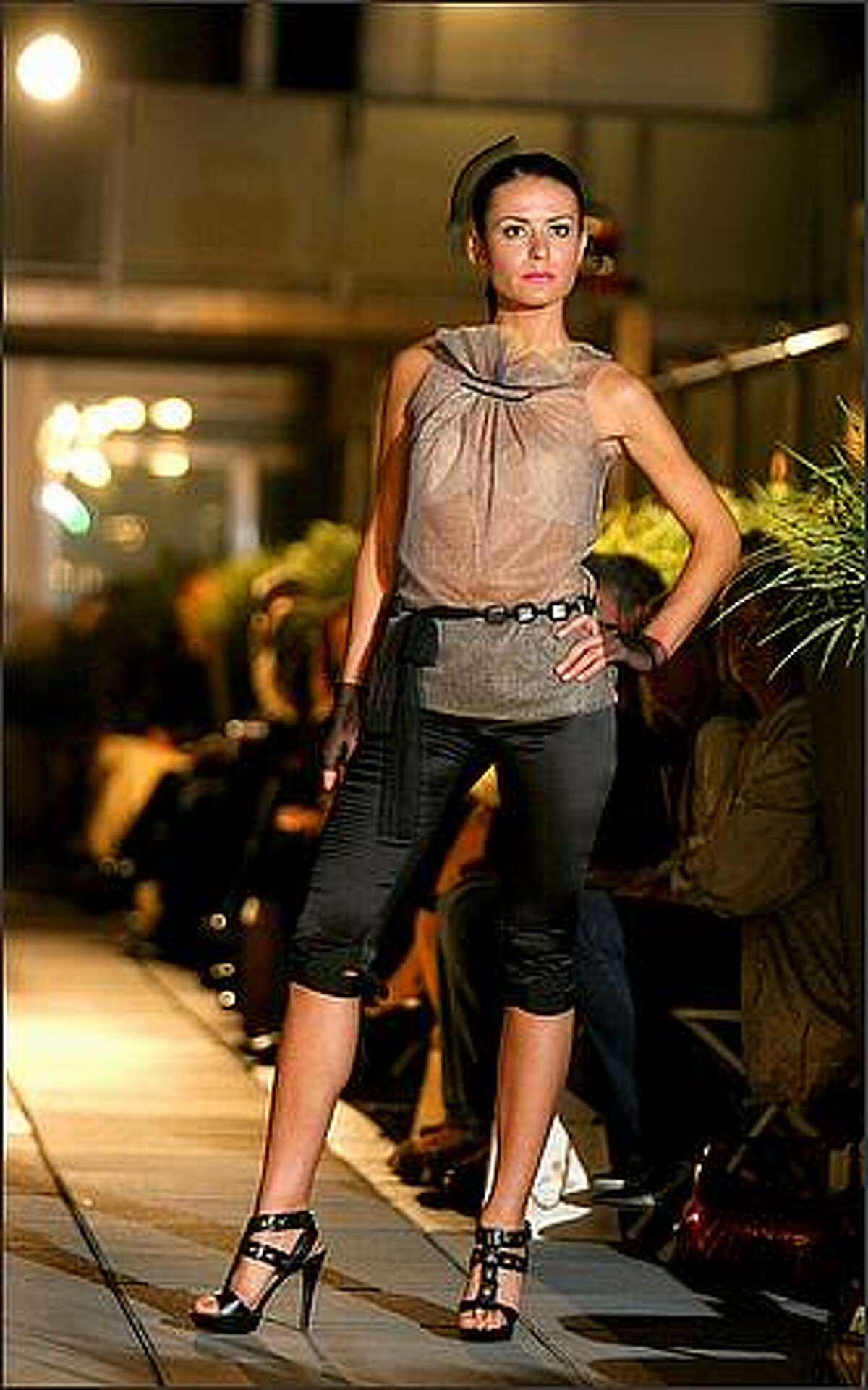 Madina Vadache unveiled her Spring 2009 ready-to-wear collection, Liquid Dreams at the Lumen Garden Courtyard in Seattle.