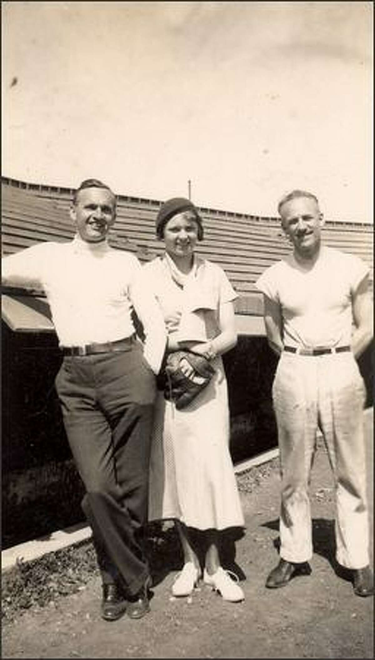 Brougham stands in California in 1932 with his daughter, Alice (who later married Dewey Soriano), and Ad Schact, who then was the trainer of the Seattle Indians and the Seattle Eskimos hockey team. Schact later became the first professional trainer in the major leagues with the White Sox.