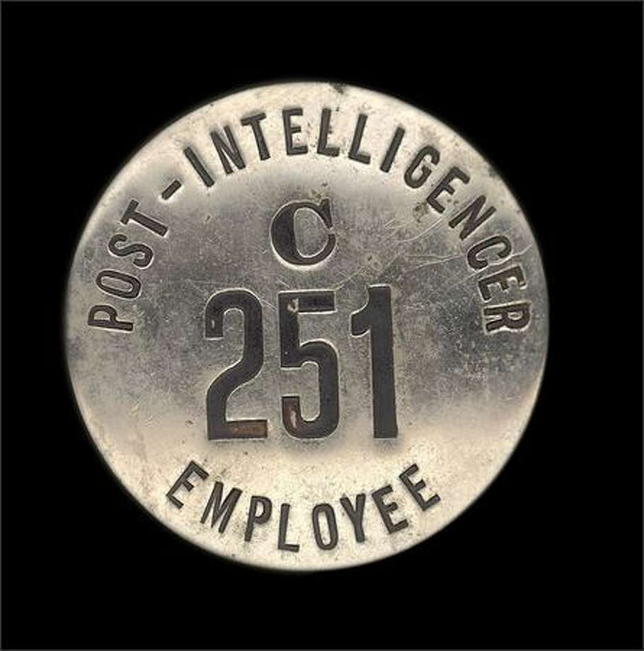 A memento of Royal Brougham's time at the Seattle Post-Intelligencer, an employee identification token.