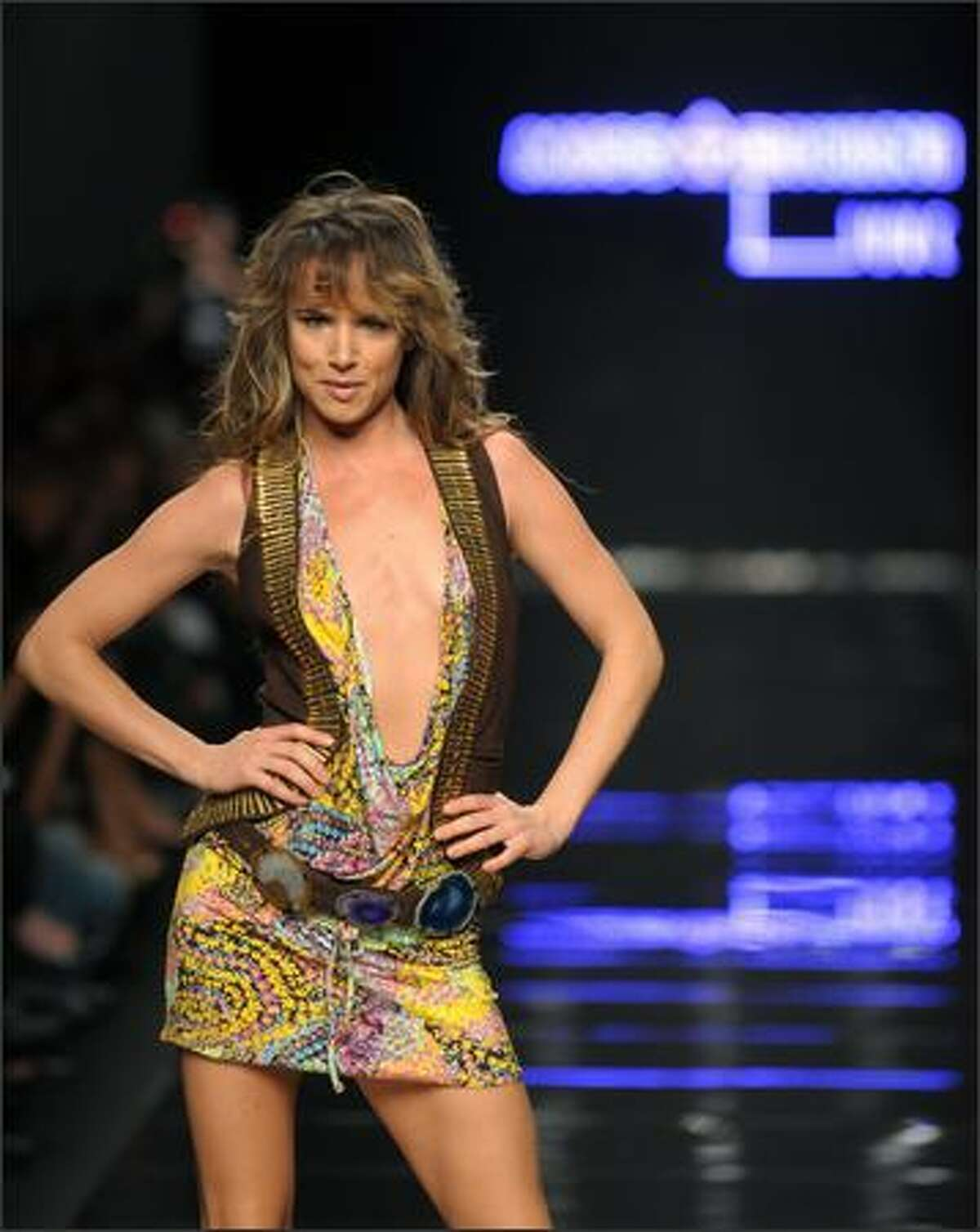 Actress and singer Juliette Lewis displays a creation by designer Miss Bikini Luxe.