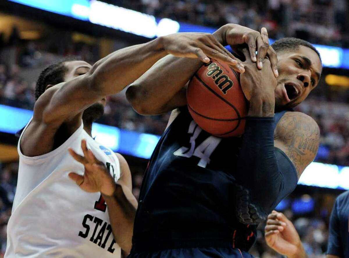 Connecticut's Alex Oriakhi (34) grabs a rebound next to San Diego State's Kawhi Leonard during the second half of a West regional semifinal in the NCAA college basketball tournament Thursday, March 24, 2011, in Anaheim, Calif. (AP Photo/Mark J. Terrill)