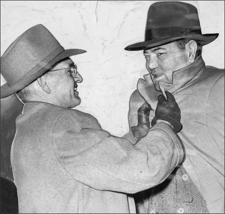 P-I sports legend Royal Brougham, left, greeted boxing legend Jack Dempsey in 1946. Dempsey, an old friend of Brougham, had come to Seattle when Brougham was named Seattle's First Citizen of 1946.