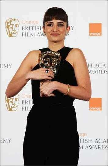 Penelope Cruz poses with award for 'Best Supporting Actress' in the Orange British Academy Film Awar
