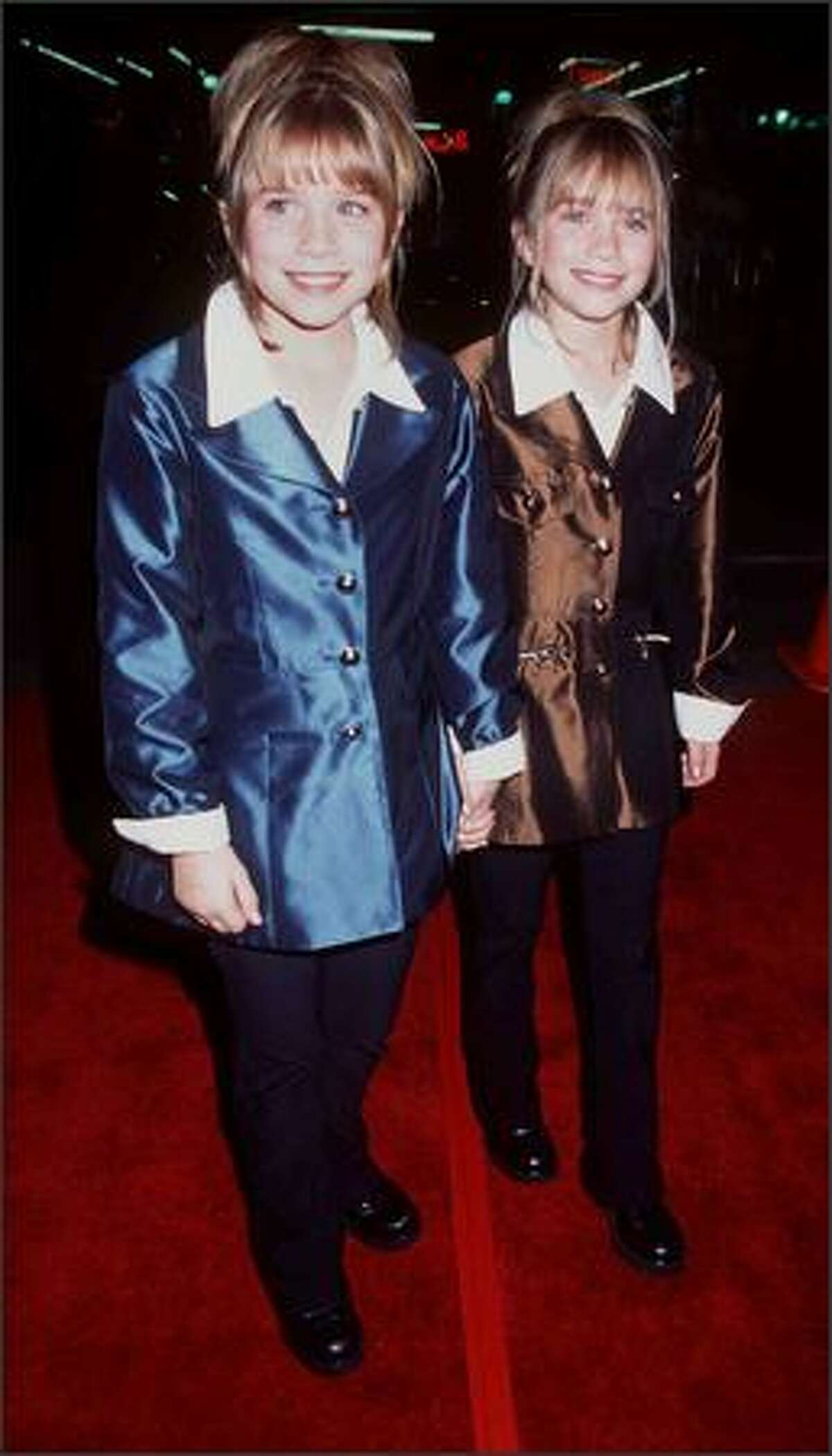 """Fortunately, this can be excused by the fact they were just 11 at the time. Mary-Kate (left) and Ashley at the premiere of """"Spice World"""" in Hollywood, Jan. 22, 1998."""