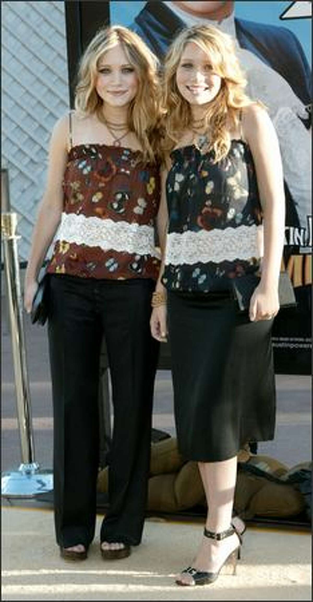 The last vestiges of the twins dressing as one ... Mary-Kate (left) and Ashley attend the premiere of