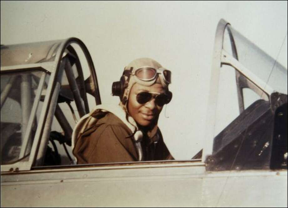 George Hickman is seen in the cockpit of an AT6 trainer plane in then-Tuskegee Army Air Field in Tuskegee, Ala. Photo: Ap
