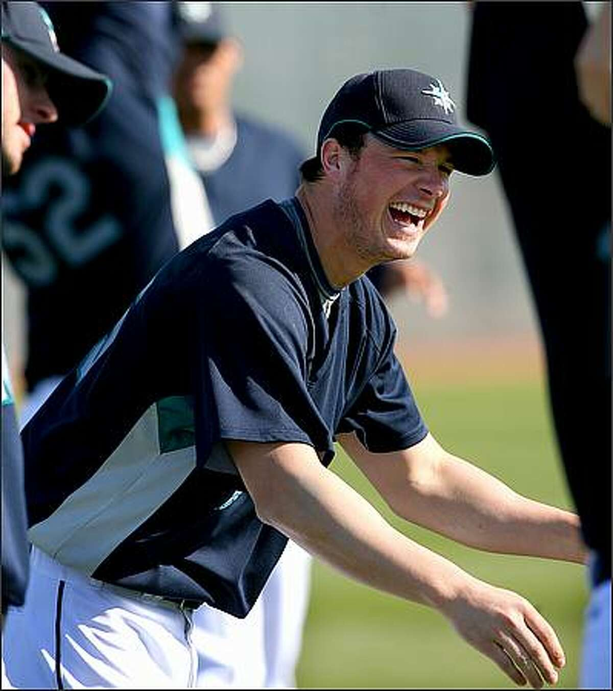 Pitcher Eric Bedard finds a moment of levity as he stretches.