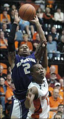 Freshman Isaiah Thomas (10 points, four assists) shoots over Oregon State's Rickey Claitt on Saturday. Photo: Greg Wahl-stephens/Associated Press