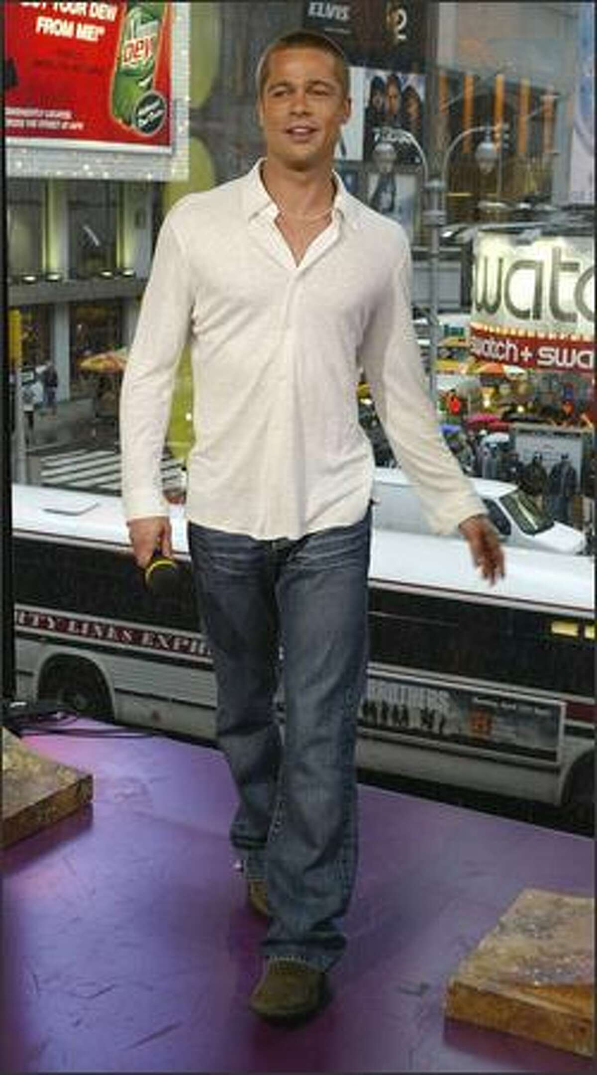 Brad Pitt attends MTV's TRL for the first time at the MTV Times Square Studio in New York, May 3, 2004.