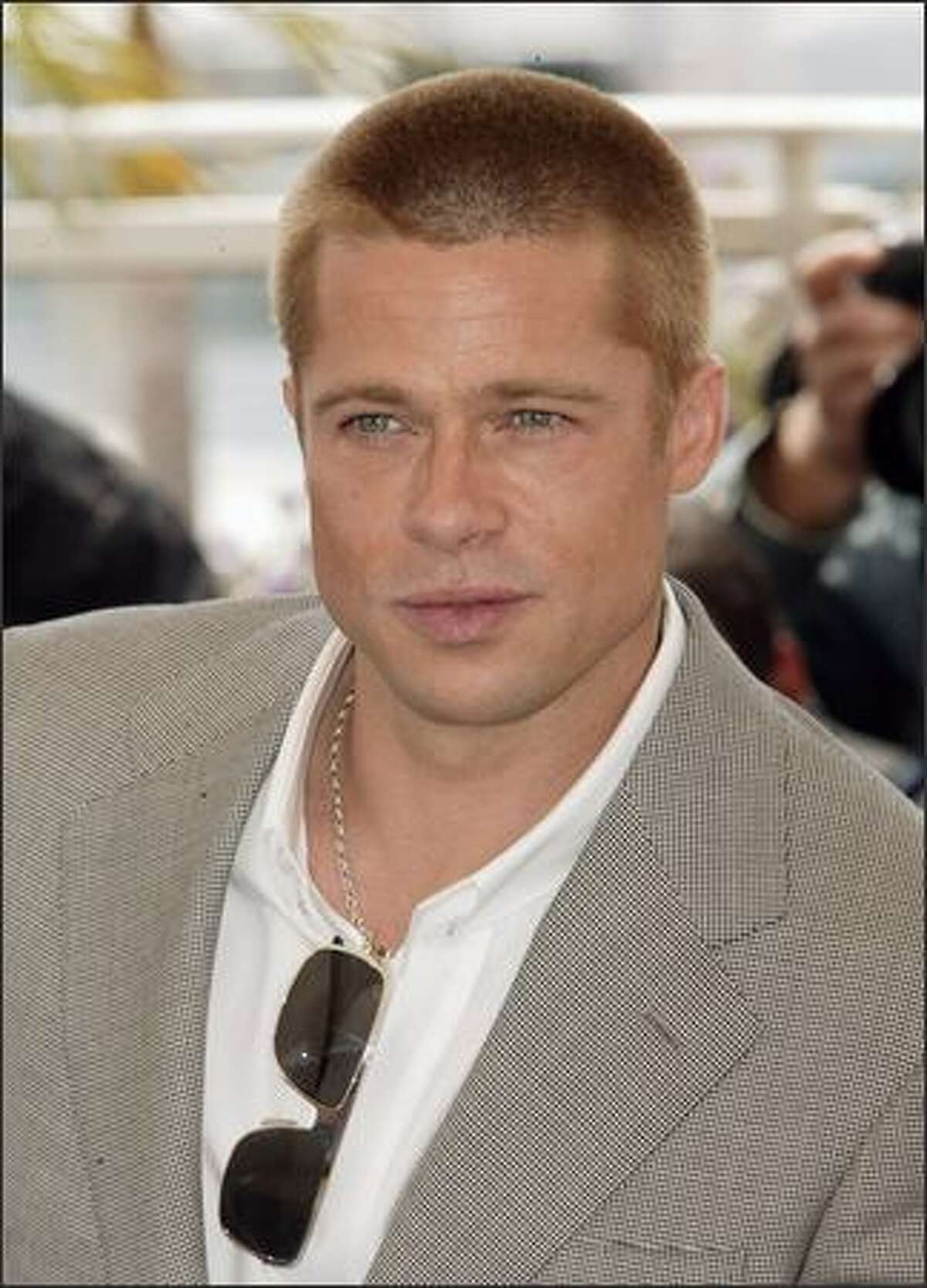Brad Pitt attends a photocall for