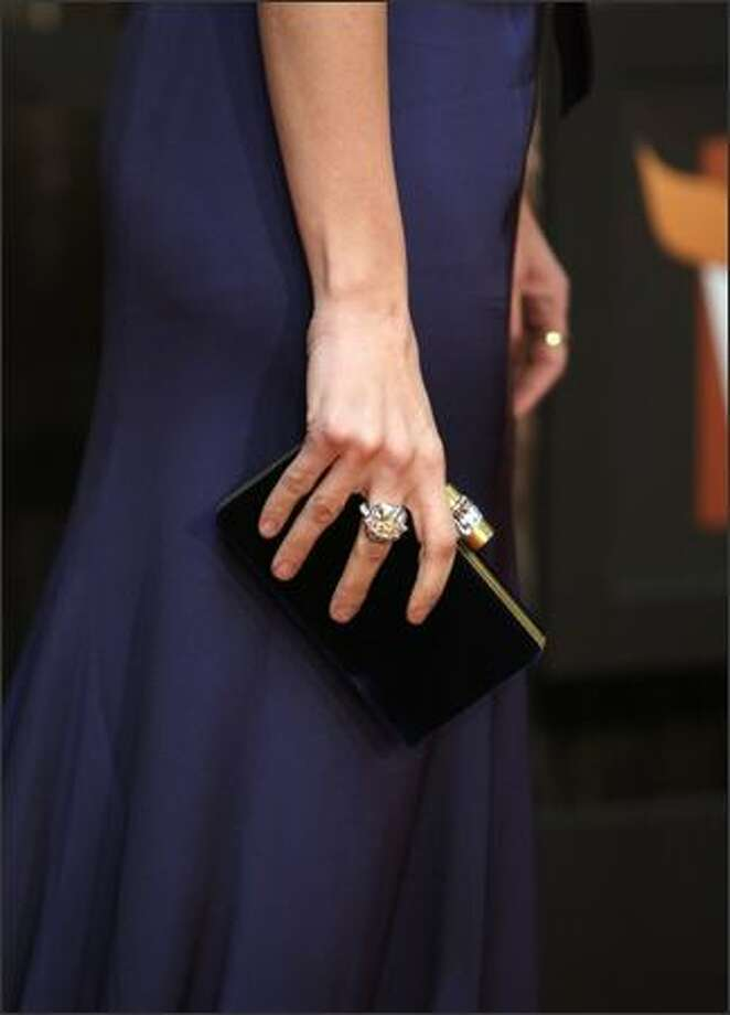 Actress Penelope Cruz shows off her handbag. Photo: Getty Images