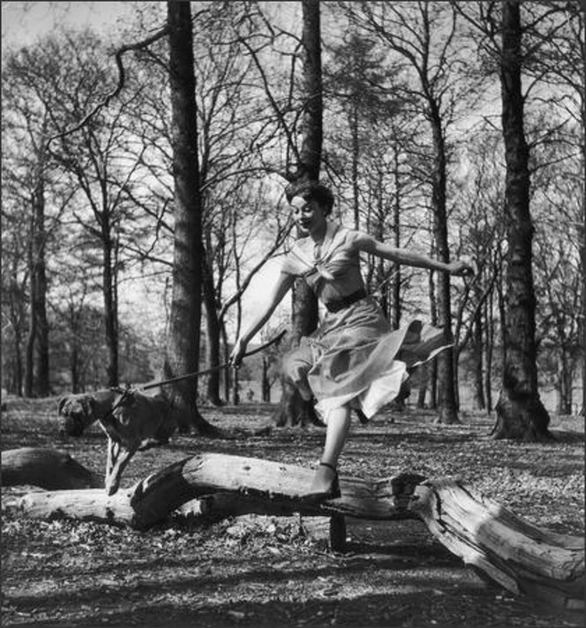 Audrey Hepburn leaping in a park in the 1950s.