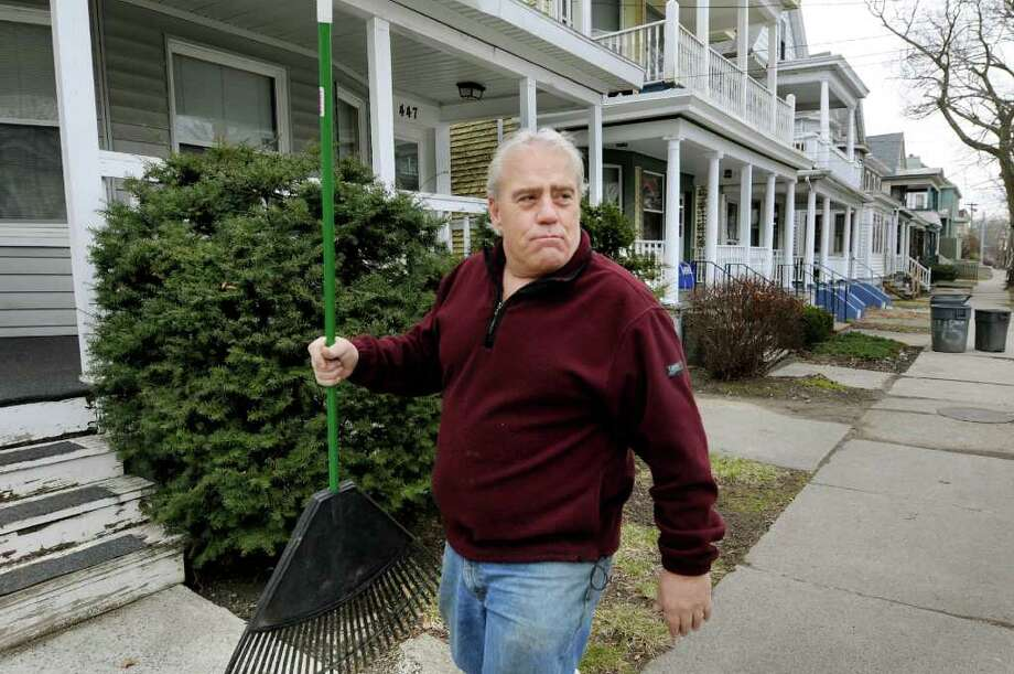 Rick Kelley, a landlord who owns 10 rental buildings on Morris Street, cleans up his properties on Wednesday, March 23, 2011, in Albany, N.Y. (Cindy Schultz / Times Union) Photo: Cindy Schultz