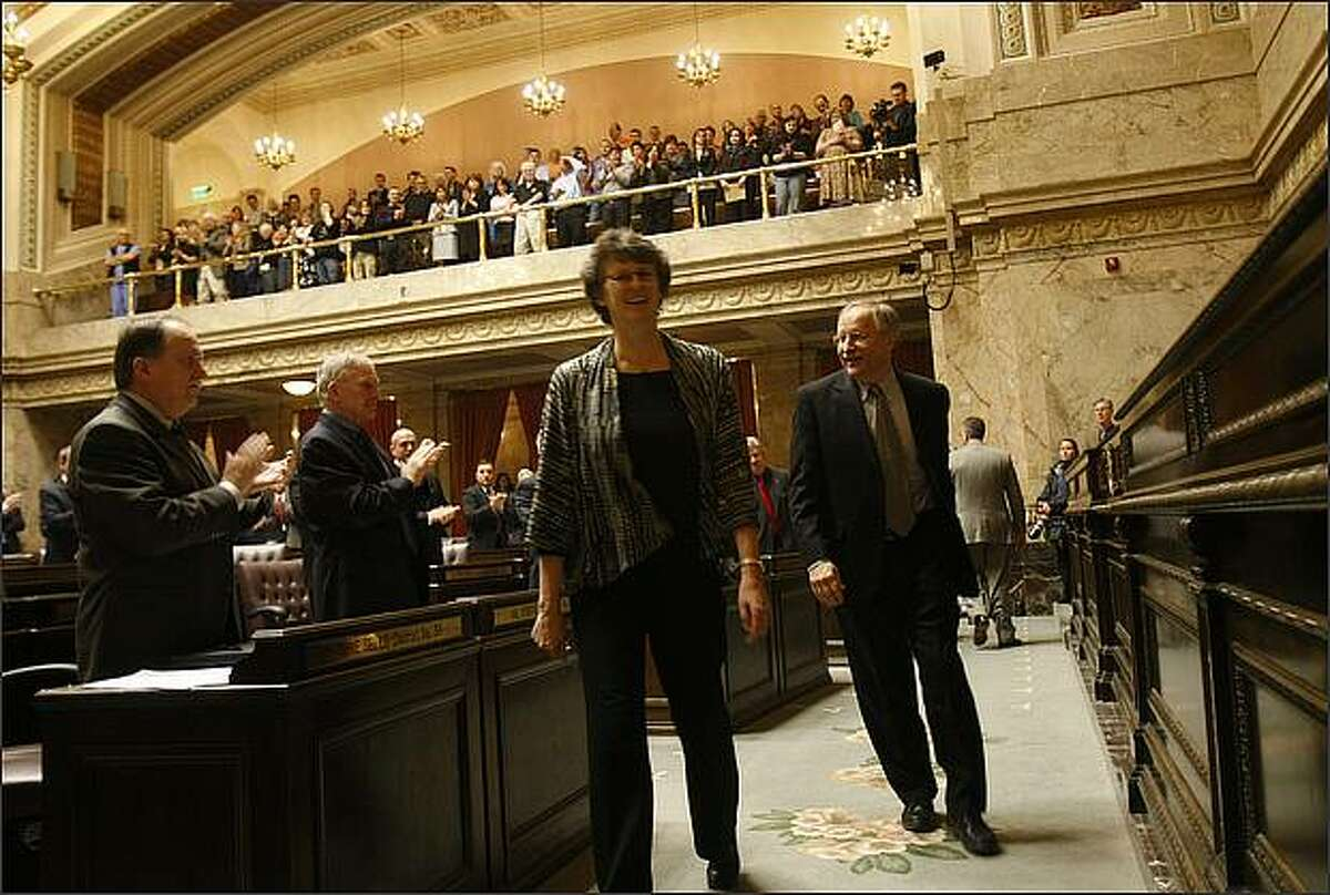 Rep. Eileen Cody, D-West Seattle, escorts Speaker of the House, Rep. Frank Chopp, D-Seattle, after he was named Speaker at the start of the new legislative session.