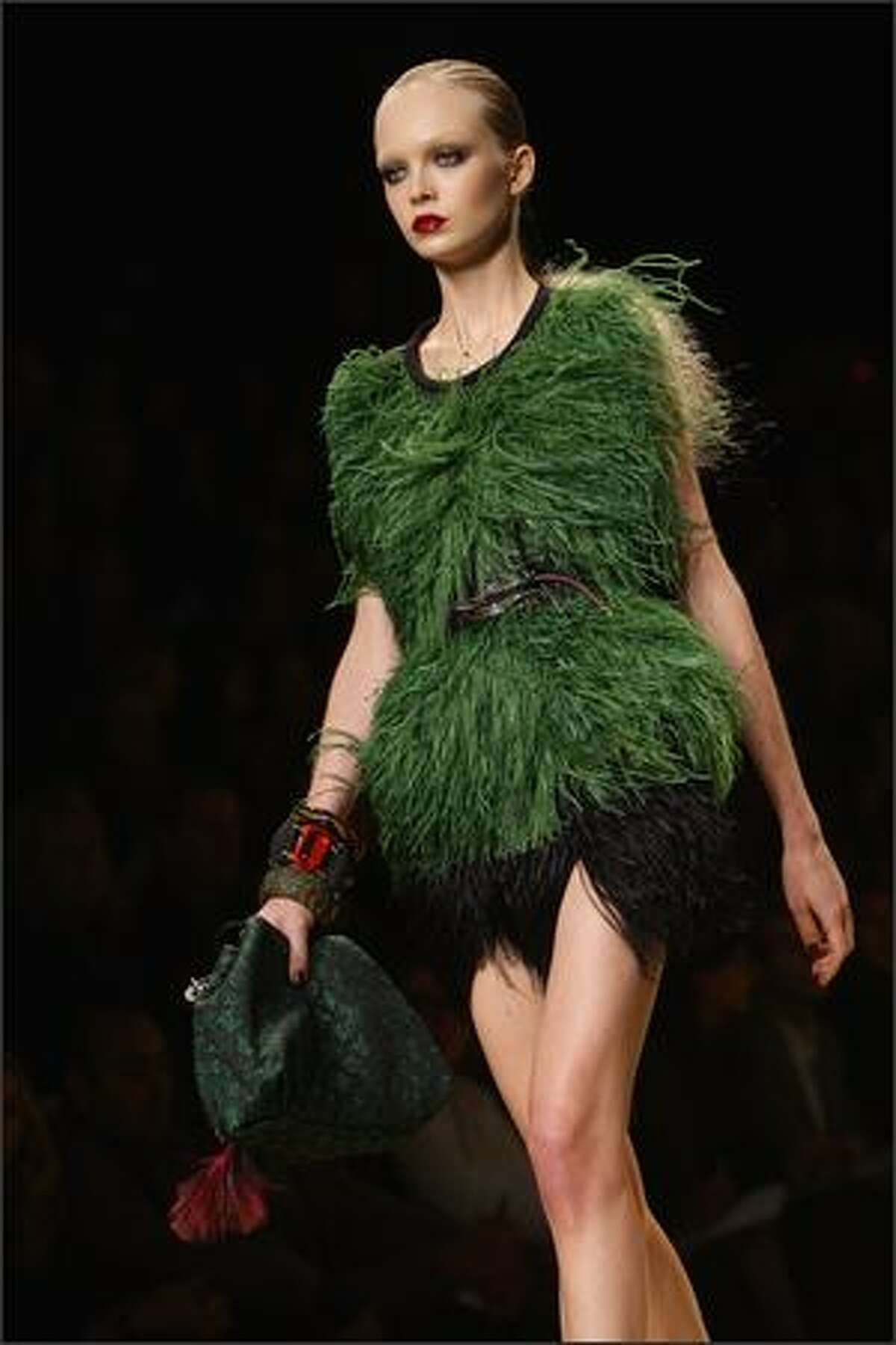 A model presents a creation by designer Marc Jacobs for Louis Vuitton during Paris Fashion Week on Sunday in Paris.