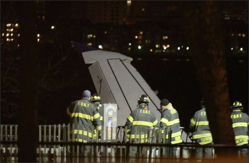 A wing of US Airways flight 1549 sticks out of the Hudson River near Battery Park City, where it was tied after it crashed.