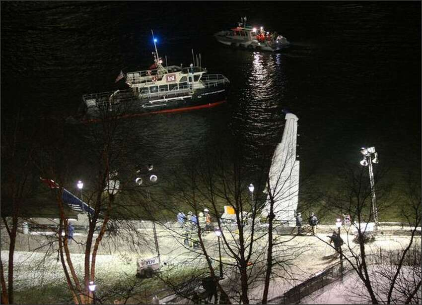 A wing and the tail section of US Airways flight 1549 sticks out of the Hudson River near Battery Park City, where it was tied after it crashed in the river.
