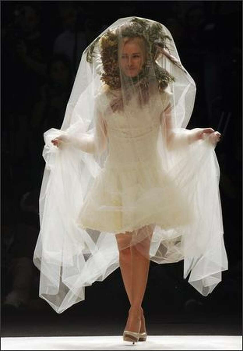 A model presents a 2009 Spring/ Summer creation by Portuguese fashion designer Ricardo Preto on the third day of ModaLisboa show event in Cascais, outskirts of Lisbon on Saturday.