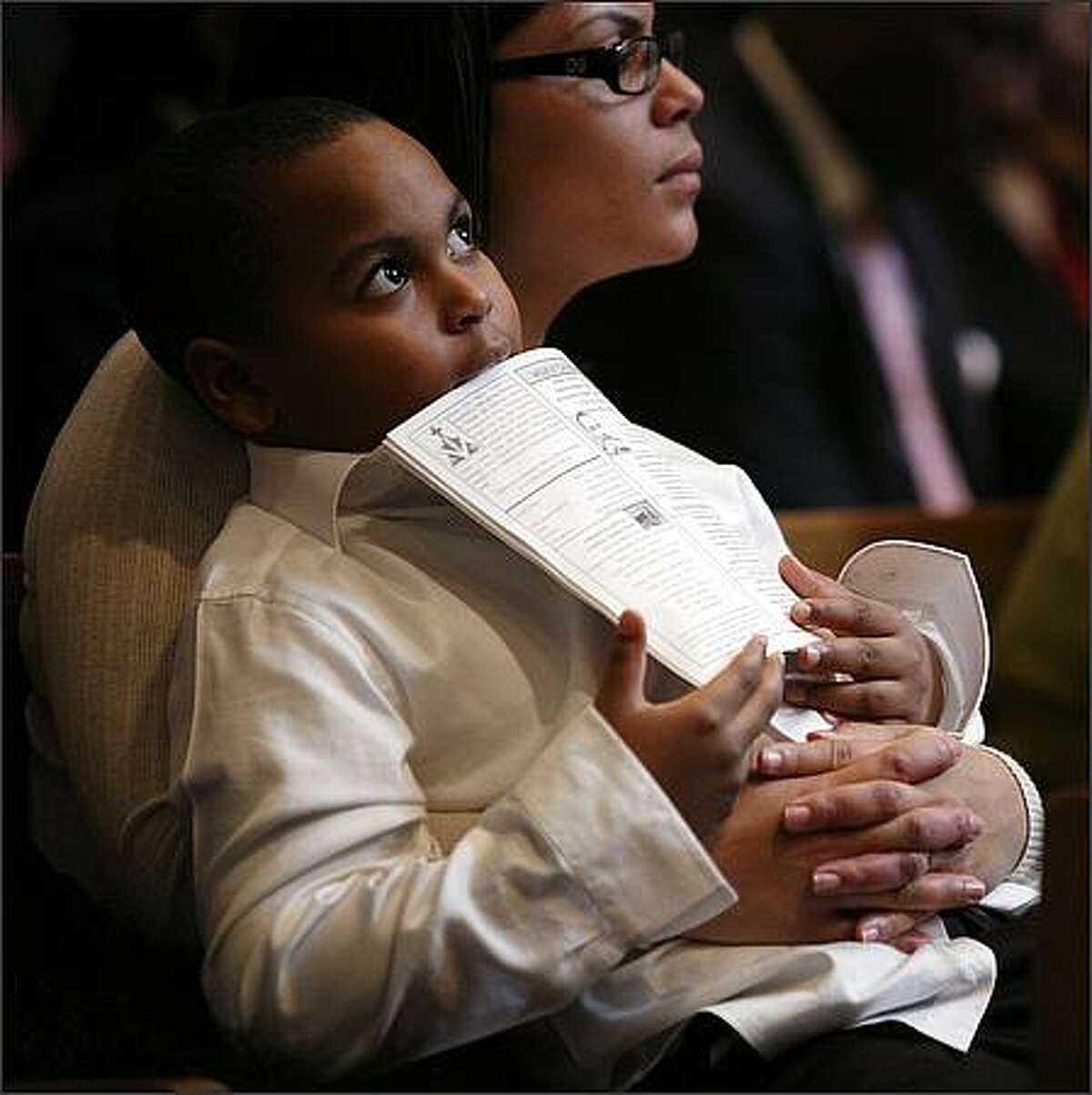 Carol Bell-Daniel holds her son Nahje Daniel, 6, during services Sunday at Mount Zion Baptist Church.