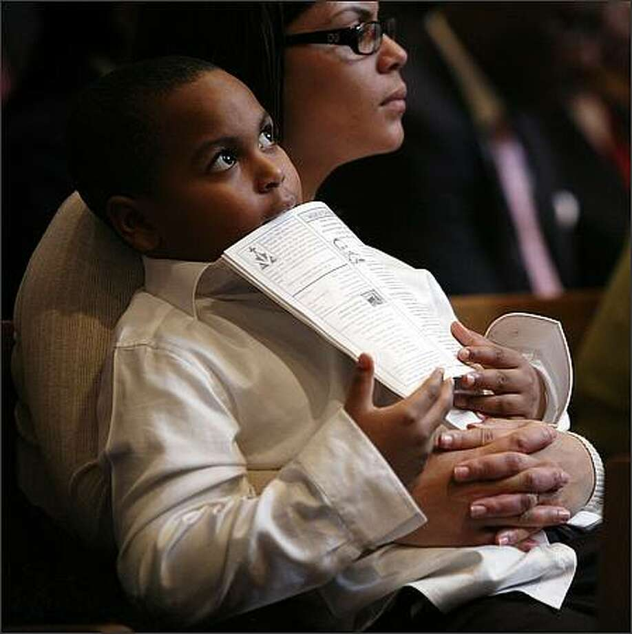 Carol Bell-Daniel holds her son Nahje Daniel, 6, during services Sunday at Mount Zion Baptist Church. Photo: Meryl Schenker, Seattle Post-Intelligencer