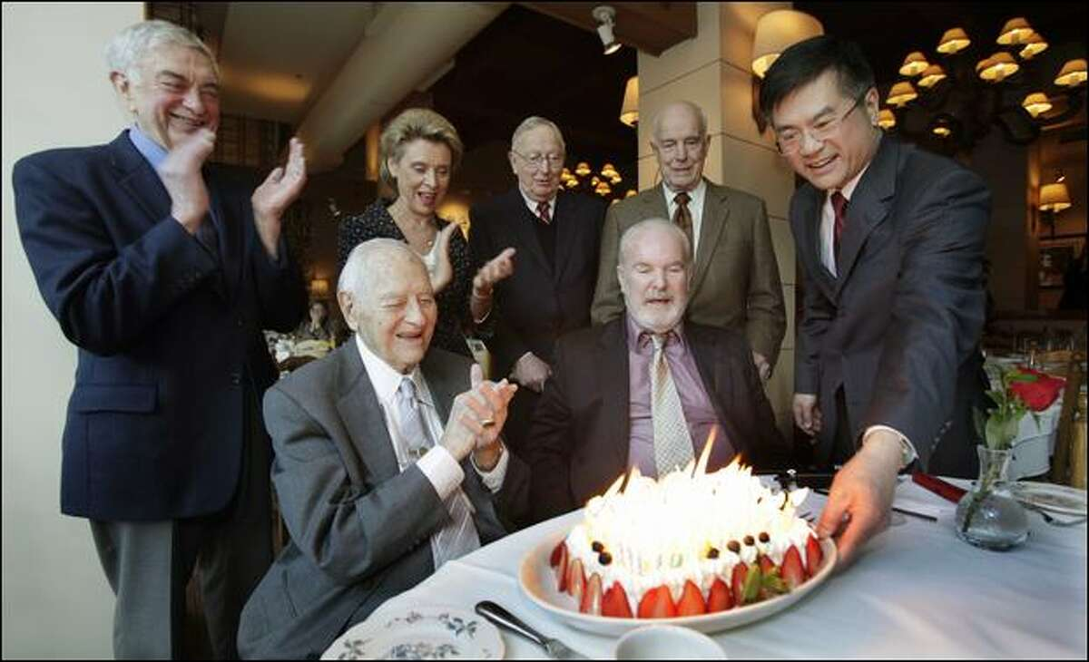 Former Gov. Albert Rosellini, who lived to be 101, was congratulated as he is presented with a birthday cake with 99 candles on it. Cheering him were former Gov. Mike Lowry, Gov. Chris Gregoire, and former Govs. John Spellman and Dan Evans. Right of Rosellini are former Govs. Booth Gardner and Gary Locke. Evans and Spellman were the state's last Republican governors.