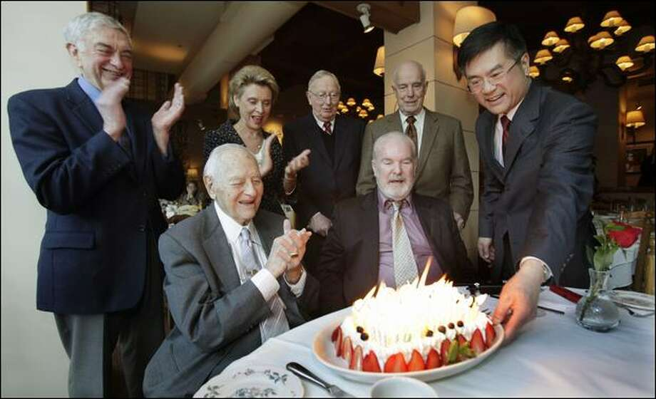 Former Gov. Albert Rosellini, who lived to be 101, was congratulated as he is presented with a birthday cake with 99 candles on it. Cheering him were former Gov. Mike Lowry, Gov. Chris Gregoire, and former Govs. John Spellman and Dan Evans. Right of Rosellini are former Govs. Booth Gardner and Gary Locke.  Evans and Spellman were the state's last Republican governors.   Photo: Ted S. Warren/Associated Press
