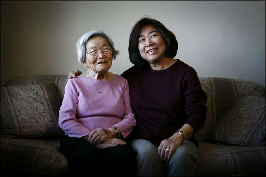 Fumiko Hayashida and daughter Natalie Ong are shown at Hayashida's Seattle home 67 years after a now-iconic photo was made of their deportation to an internment camp. Photo: Joshua Trujillo/Seattle Post-Intelligencer