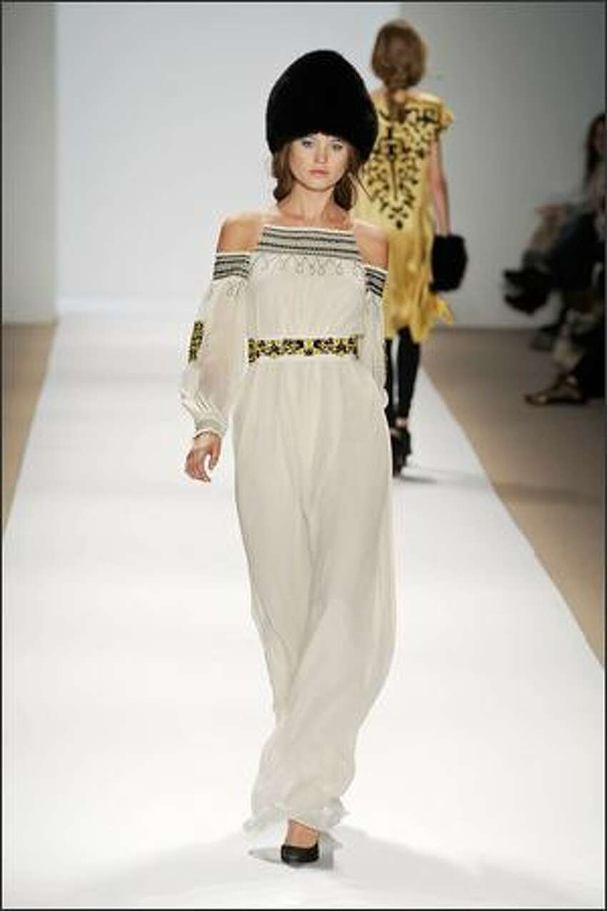 A model displays a creation by Tibi.