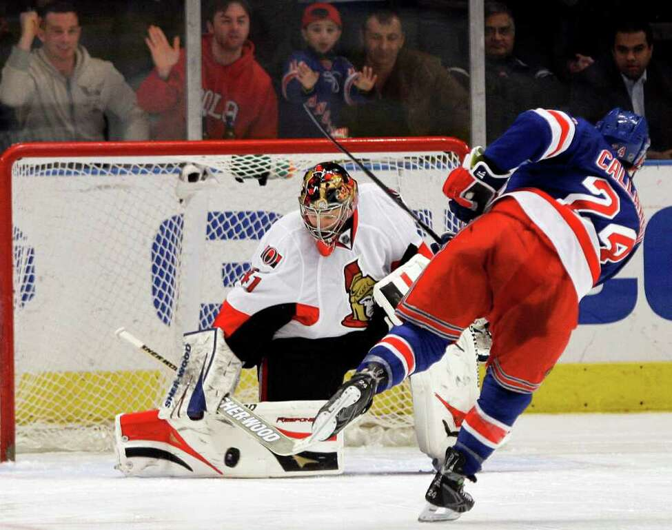 Ottawa Senators goalie Craig Anderson (41) blocks a shot on the goal from New York Rangers' Ryan Callahan (24) during the shootout period of an NHL hockey game on Thursday, March 24, 2011, in New York. The Senators won the game 2-1. (AP Photo/Frank Franklin II)