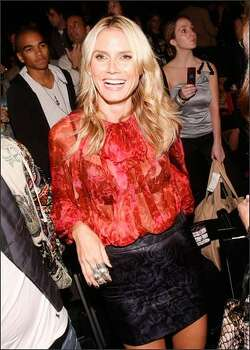 Model Heidi Klum poses in the front row at the Christian Audigier Presents American Lord Spring 2009 fashion show during Mercedes-Benz Fashion Week held at Smashbox Studios on Wednesday in Culver City, Calif. Photo: Getty Images
