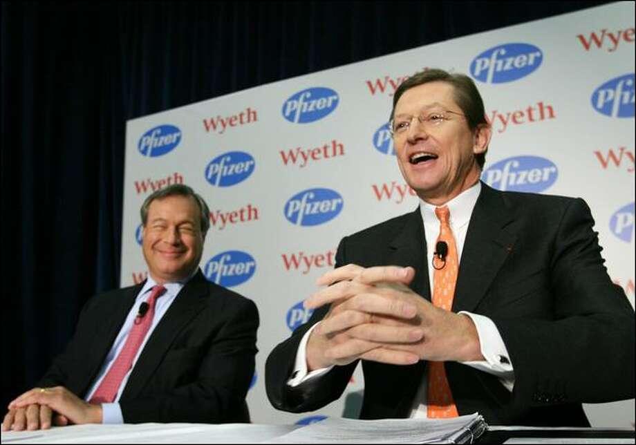 Pfizer to buy Wyeth, cut 8,000 jobs - seattlepi com