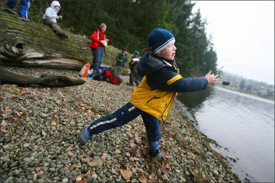 The judges award him a 9.5! Conor Manley, 6, displays excellent form – note the extension on the follow-through – skipping a rock on Lake Washington during an unstructured outing at Seward Park. Photo: Scott Eklund/Seattle Post-Intelligencer