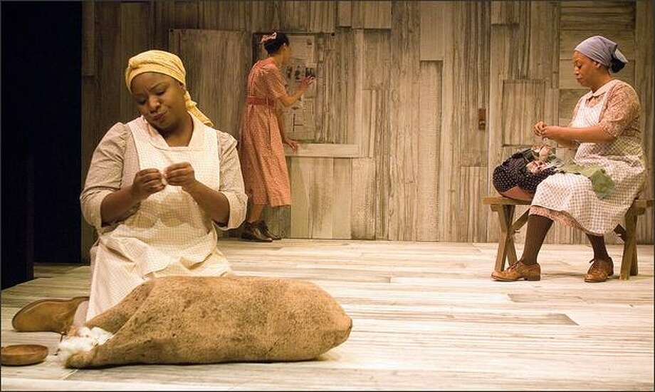 """Tracy Michelle Hughes, left, Samantha Rund and Faith Russell perform in Taproot Theatre's production of """"Gee's Bend."""" Photo: Erik Stuhaug"""