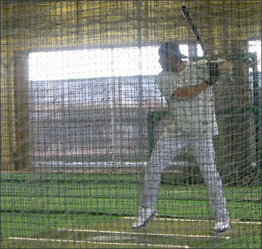 Ken Griffey Jr. strikes a classic pose as he takes 11 minutes of batting practice at the Mariners' spring training facility in Peoria.