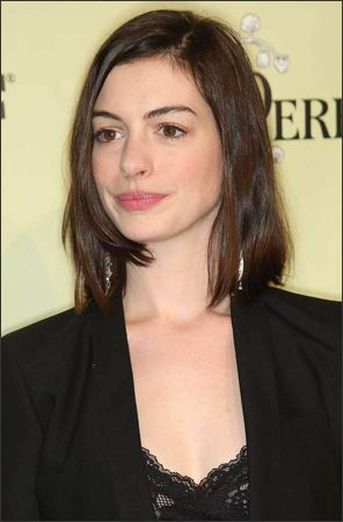 Actress Anne Hathaway attends the party.