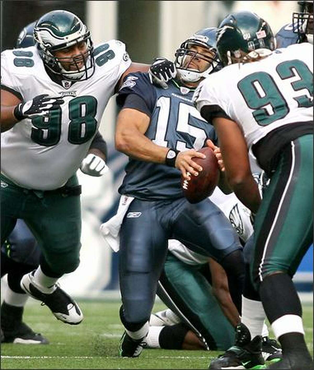 Quarterback Seneca Wallace is pressured in the pocket by defensive tackle Mike Patterson as the Philadelphia Eagles beat the Seahawks 26-7 at Qwest Field on Nov. 2.