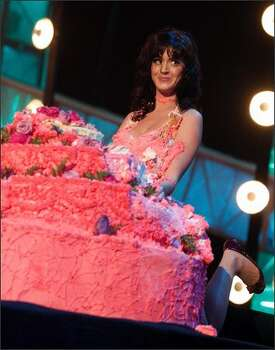 Singer Katy Perry rises from the cake. Photo: Getty Images