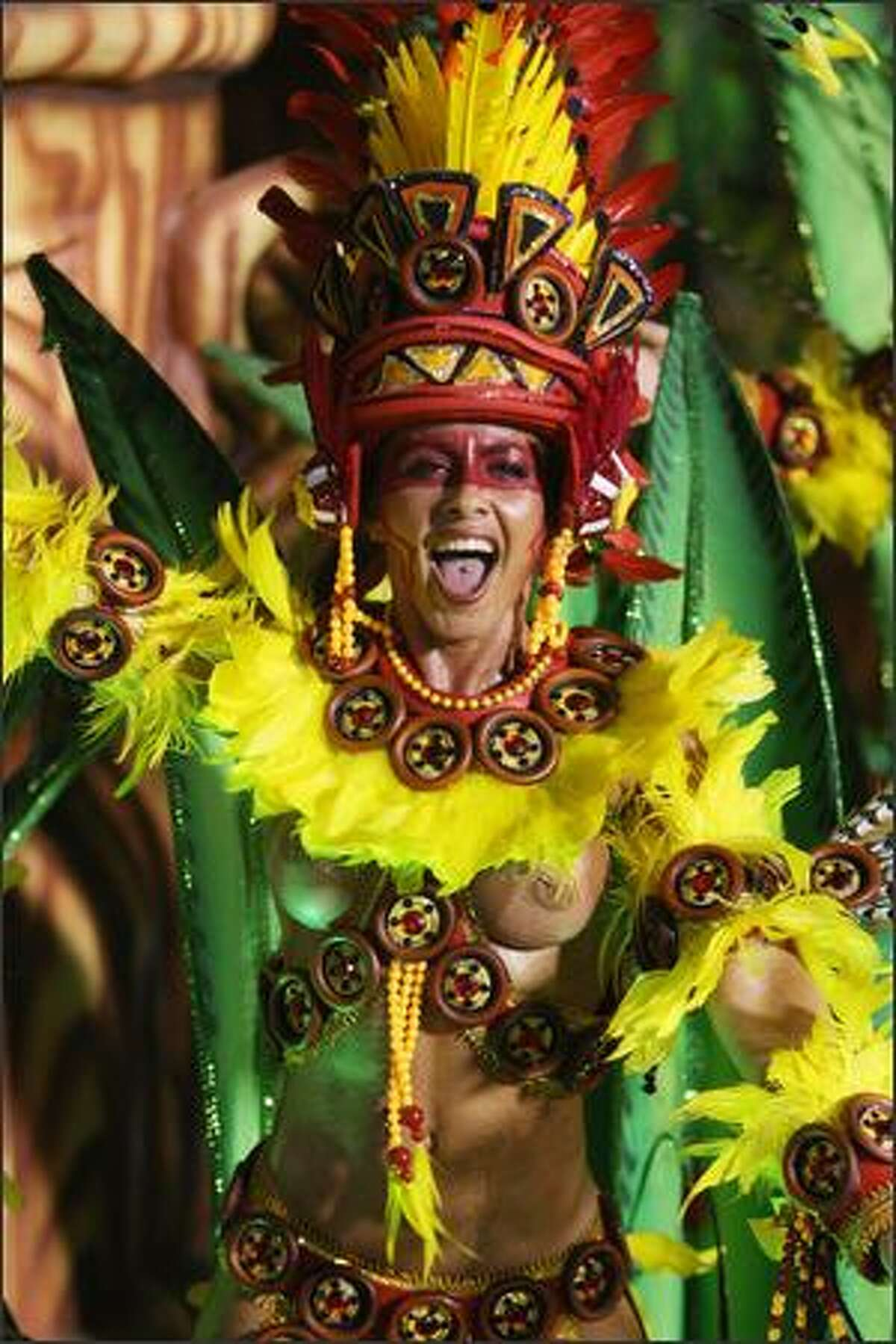 An Academicos do Grande Rio samba school dancer performs down the Sambodrome on the first night of the Carnival samba school parade in Rio de Janeiro, Brazil on Monday. Carnival is the biggest and most popular celebration in Brazil and runs throughout the country until February 24.