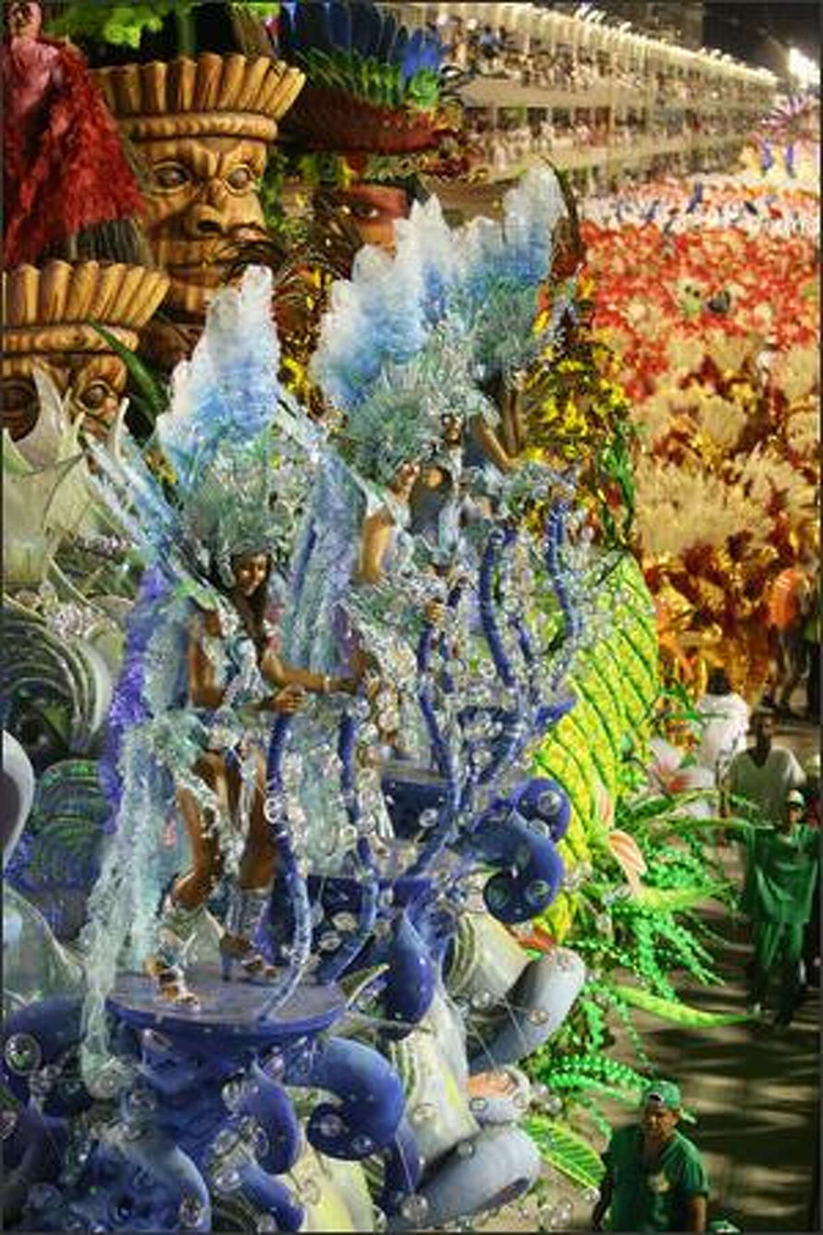 Academicos do Grande Rio samba school dancers perform down the Sambodrome on the first night of the Carnival samba school parade in Rio de Janeiro, Brazil on Monday. Carnival is the biggest and most popular celebration in Brazil and runs throughout the country until February 24.