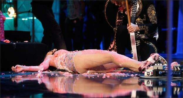 Katy Perry falls after jumping on a cake during her performance. Photo: Getty Images