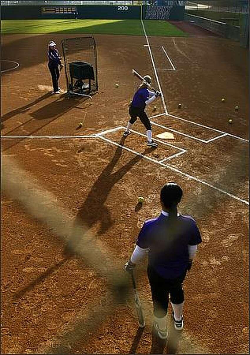 The University of Washington softball team practices at Husky Softball Stadium.