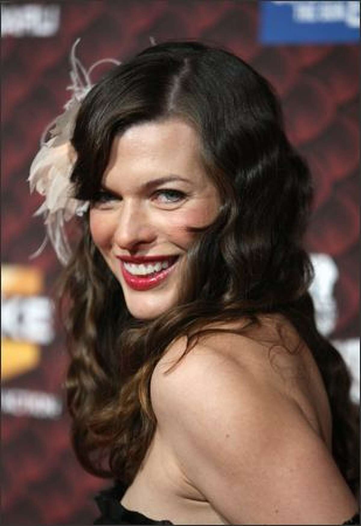 Actress Milla Jovovich arrives at Spike TV's 2008 Scream awards held at the Greek Theater on Saturday in Los Angeles, Calif.