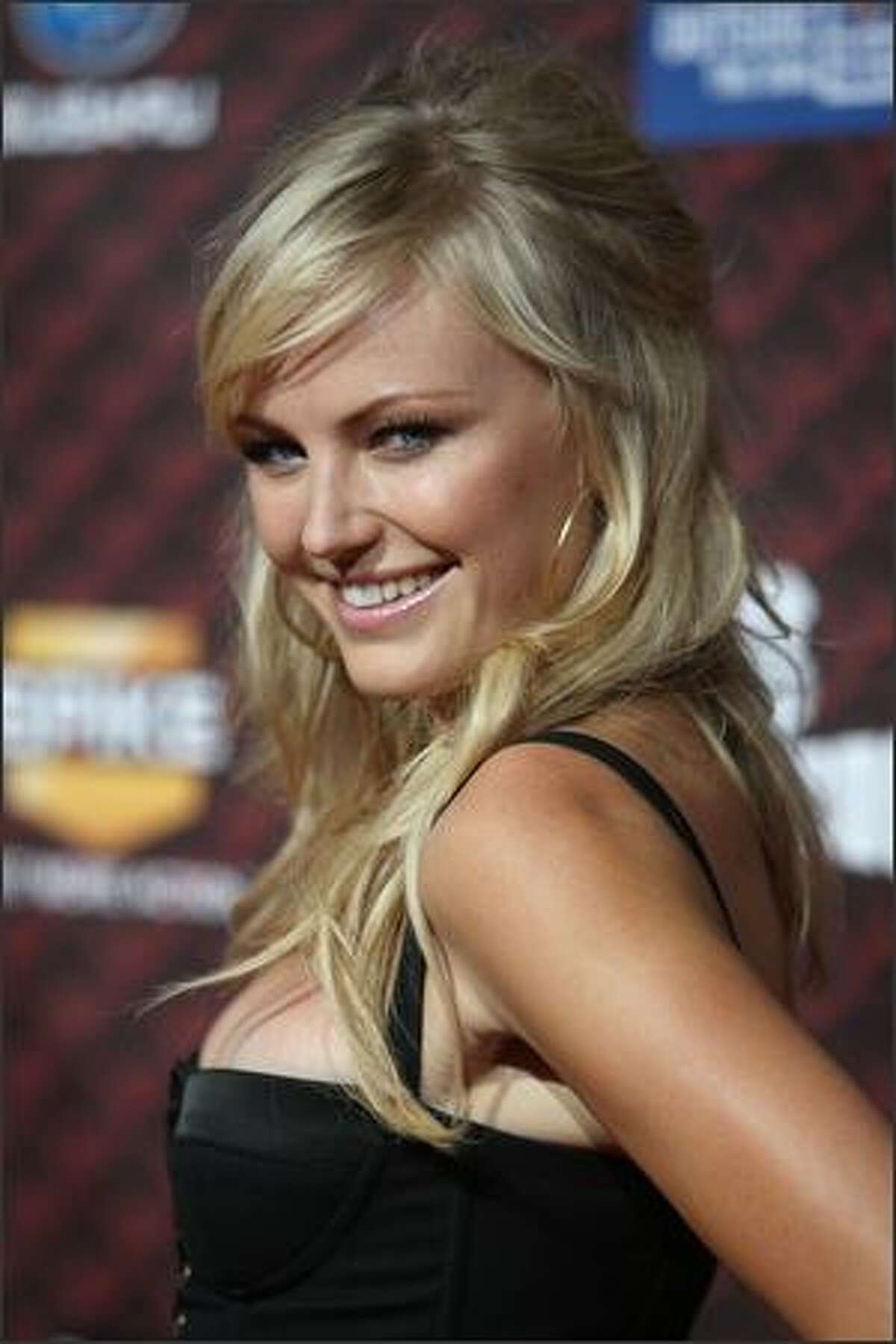 Actress Malin Ackerman arrives at Spike TV's 2008 Scream awards held at the Greek Theater on Saturday in Los Angeles, Calif.