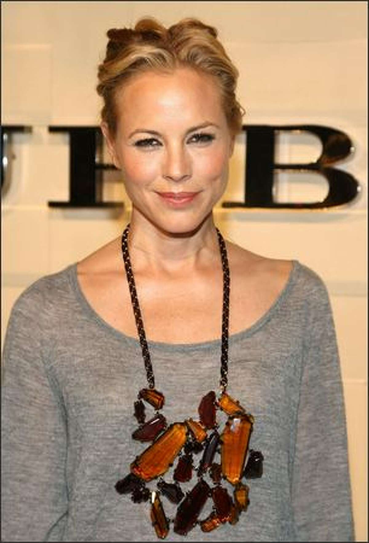 Actress Maria Bello arrives at the grand re-opening of the Burberry Beverly Hills store in Beverly Hills, California.